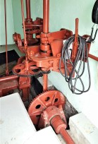 Opens and closes the gates and controls the valves