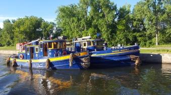 Canal maintenance tugboats