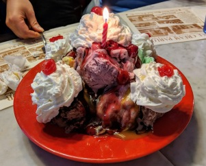5 huge scoops of ice cream, 3 toppings and whipped cream!