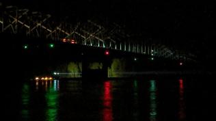 Tug coming under the bridge