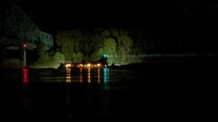 Huge spotlights lighting up the woods